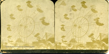 Stereograph image of people riding a ferris wheel.