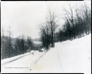 Entrance Gate to the Monongahela National Forest in winter, located 5 miles east of Elkins, W. Va. on U. S. No. 33.  (The gateway was constructed of stone taken from the chimneys of the Ezekial Harper Homestead on Clover Run in Tucker County.) O. Homer Floyd Fansler, Hendricks, W. Va.