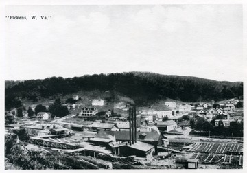 'Lumbering and logging town in early 1900s.'