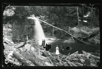 Men, women, and children hike below Douglas Falls in Tucker County, W. Va.