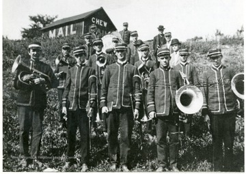 Members of the Taylor County Band standing on a hillside.  Third from right with trombone is Dr. Charley Brown