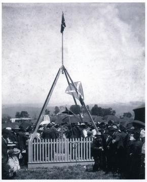 View of the unveiling of the Confederate Monument at Valley Mountain near the Marshall Farm at Mingo Flats.  The occasion recognized General Robert E. Lee's nearby 1861 campsite and the Confederate dead of the areas.  Present for the occasion were: Mr. and Mrs. Edgar D. Wamsley, Zano Simmons, Jake G. Simmons, Ellen B. McDonald, Reverand William E. Hudson, M. Hart Wamsley, Joe See, James Ware, Mary Crouch, and George Fisher.