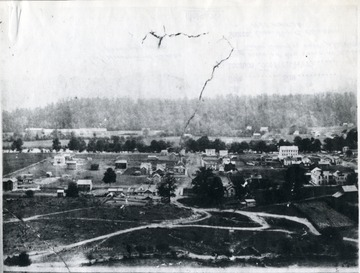 'Picture was taken from the grade school hill. K of P Building No. 1.  Advocate Building No. 2.  O. Homer Floyd Fansler, Hendricks, W. Va.' is written on the back of the photo.