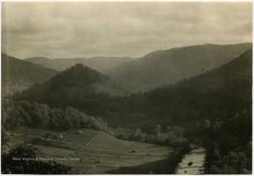 'A recreation reserve around Point Mountain would comprise inspirational scenery, the attractiveness of which is due largely to the sheltering mantle of green timber. Elk River Valley several miles about Webster Springs. Bureau of Agricultural Economics Photographs Division'