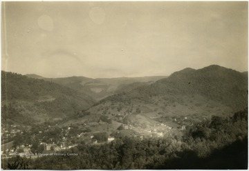 'Webster Springs, the county seat of Webster County, was formerly a thriving health resort well known for its mineral waters. Point Mountain, one of the most scenic ranges in the Alleghanies, rise here at the junction of the Elk River and the Back Fork of the Elk. Bureau of Agricultural Economics Photographs Division Negative Number 18485.'