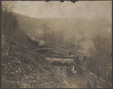 Railroad employees inspect the damage.