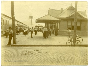 People on the platform at a Railroad Station, New Martinsville, Wetzel County, W. Va.