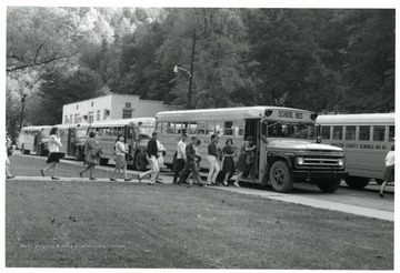 """At 3:30 p.m. 'students rush out to buses waiting to be loaded.'"" Webster County Students Boarding Buses, Webster County, W. Va."