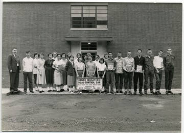 Driver Education Class, 1956, Webster County, W. Va.  Front Row Pictured Left to Right:  Robert Andrick (Instructor), Elbert Gum, Arvilla Pugh, Margaret Shipman, Mary McCoy, Ania Schrader, Aaron Chapman, Bill Gibson, Joey Friend, Bill Hull, Roger Hall, Raymond Gregory and Bernard Lewis.  Back Row Pictured Left to Right; Willavene Riffle, Norma Shears, Shirley Eubank, Mava Helmick, Jane Wilson, Molly Pulliam, Carolyn Foreman and Macel Lowther.
