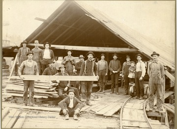Right- Luther Wiles of Ruthbelle, W. Va. Left- Charey Lants of Aura, W. Va. (holding flank, back row),  _, Charles Homes, Shilo Dumire of Elkins, W. Va., Oliver England (setting down), Joseph Summers (sitting down), Ely Wilfong, _ Helmick, Charles Poling of Elkins, W. Va., Elmer Dumire, French Renick and daughter of Parson, W. Va., Isac Wilfong of Montrose W. Va., Dave Wilhelem (boy sitting down).