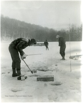 Three men fishing at Cooper's Rock trout pond.
