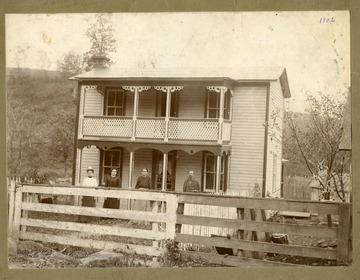 Three ladies and a man are standing in front of Tom Watkins' home in Marquess, Preston County, West Virginia.