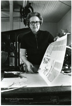View of Mrs. Jane Price Sharp looking over proof pages of her Marlinton, W. Va. weekly paper, The Pocahontas Times.