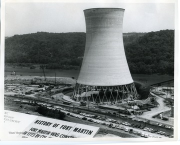 A view of Fort Martin Power Plant in Monongalia County, West Virginia. A sign describing the history of Fort Martin is partially visible.
