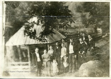 """Picture copied from tintype.  This picture was taken at Webster Springs during the summer of 1883.  The three in the front row are Davy Byers and wife and Frank L. Johnson.  Isaac V. Johnson and wife and J.M. Woodford are in second row.  I do not know the lady on father's right and in rear of mother.  I do not know the two ladies and gentleman in rear.  Who knows the ones not known to me?""  L. Johnson  ""The lady on father's right is Miss Albina Morrall, daughter of L.D. Morrall, of this place.  The lady in the rear of mother is Miss Anna Manley, probably from Marion County.  The one to the left of J.M. Woodford is his wife, and the two back of Mrs. Woodford are William Robinson and his daughter, Miss Mollie.  William or ""Uncle Billy"" as we all knew him, was the father of Judge Ira E. Robinson, now on the radio board of the nation.""  A.S. Poling"