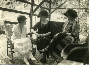 On Davis porch or yard in vineyard.  Left to right- Mrs. James Jackson, Mrs. John W. Davis, and unidentified.
