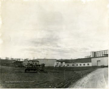 'Foreground, Agricultural Engineering Building; background right, Agricultural Sciences Building; background middle, greenhouses.'