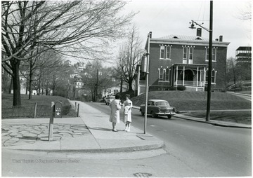 Female students across the street from the Agricultural Experiment Station building.