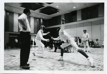Two fencers are participating in a competition.