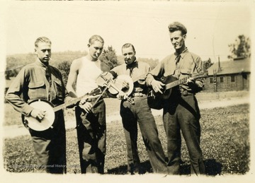 Four men with musical instruments, including banjo, guitar, and violin at Camp Crawford. Camp Crawford was a base for Company 1512 in the Charleston District, Fifth Corps Area.