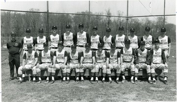 "First row left to right- Denny Taylor, Bob Reed, Tom Tomechko, Buck Guth, Mike Moschel, Jim Clay, Bob Beahm, George Begalla, Fred Smith, Sam Ellis.  Second Row-  Assistant coach Ted Seminik, Bruce Chapnick, Dave Phillips, Dave Ferguson, Rick Wagener, Bruce McCutcheon, Larry Seafert, John Knoll, Don Shearer, Dick Whitman, Jack Simpson, Skip Hines, Head Coach Dale Ramsburg, Trainer A. C. ""Whitey"" Gwynne."