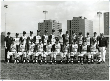 Team portrait was taken on a diamond near the residents towers on the Evansdale campus.