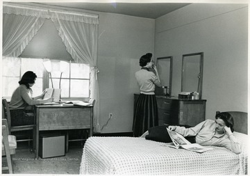 Three women in room at Arnold Hall.