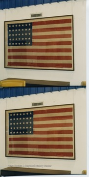 The 35 star flag hanging in the WV Collection represents the time period when West Virginia was the state most recently admitted into the Union in June 1863.