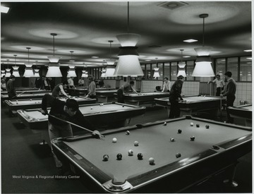 Students playing pool at the recreation room.