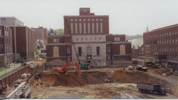 Shows early excavation work in progress in front of Wise Library. Front entrance closed.  Side entry to Wise was the main entrance to the library at this stage.