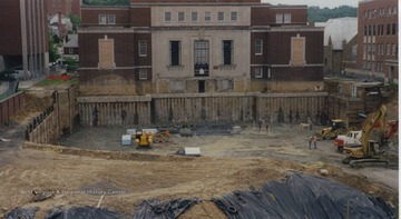 Shows early excavation in front of Wise Library.  Outer wall of basement level of Wise is visible.
