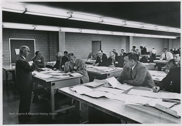 View of Harold Cather speaking during an exam for registration of engineers.