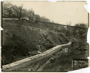 Preparing ground for excavation of Mountaineer Field, West Virginia University, looking northeast up Falling Run Hollow.