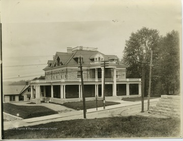 Purinton House built in 1905.  Poster on pole reads, 'Baseball Saturday, May 5'  Note: Trolley car tracks, gas lamp pole.