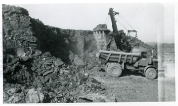 'Power shovel at work on hill before the Medical School.'