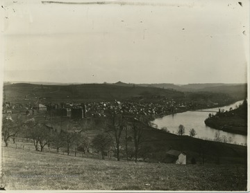 'West Virginia University and Morgantown (1891-1892) as taken from a point some distance north of the U. The Catalogue for one of those subsequent years states that Science Hall was finished in 1893, but no sign of it is to be seen in this picture, but the roof was on Commencement Hall, and the Court House was built (1892), which fixes the date about as given above.' 'View of Morgantown & Sunnyside taken from North Morgantown Hill. Note the orchard along Overhill St. also showing the house owned by the Whites nearby.'