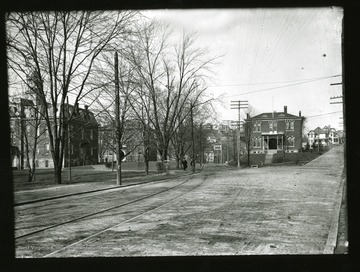 View of Martin Hall (left), Chitwood Hall-Science Hall (middle back), and Experimental Station (right). 'Reprinted from WVC negative by WVU Department of Radio, TV and Motion Pictures for WVU Centennial filmstrip.'