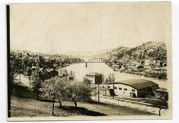 View of Basketball Hall, 'The Ark', West Virginia University, completed on November 4, 1916 and other downtown campus buildings and the Monongahela River in the background.  Steel bridge over the Monongahela river in the background.