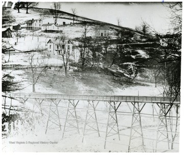 Caption: 'Footbridge where the Stadium Bridge (University Avenue) is now located.' This bridge, over Falling Run, connected the campus to Sunnyside.
