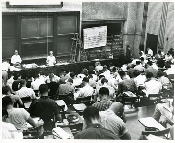 'In Chemistry Building Auditorium before 1965 remodeling.  Probably a freshman class.'