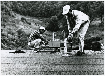 'A circular section of the Raleigh County test highway in being removed to be investigated for its durability. The sample resembles the disk which is made in the WVU laboratory.'