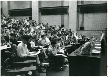 'In Chemistry Building auditorium before 1965 remodeling.  James Hall, Instructor.'