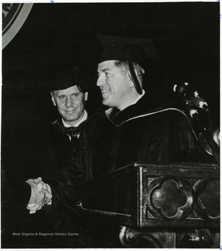 'Left, President Paul A. Miller; right, Joseph S. Farland '36 former ambassador to Dominican Republic and Panama, now with Georgetown University.'