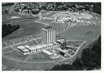'Towers Dormitory and Forestry Building under construction, Agricultural Sciences Building, Engineering Building, and Agricultural Engineering Building.'