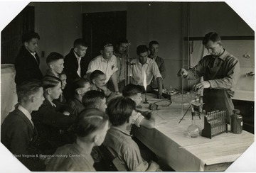 Instructor performing an experiment.