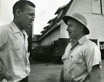 Left to right, Ira Deward Porterfield, Professor and Head of Dairy Husbandry, Clark Hardman Taylor, Dairy Farm Superintendent.