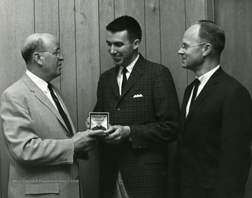 Left to right, Dean C. M. Frasure, Arts and Sciences; H. D. Price; Dr. G. L. Humphrey, Professor and Associate Chairman, Chemistry.