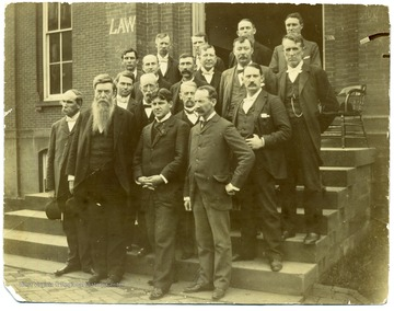 'Second Row, from right, front row: Robert Armstrong (English Department), Second from right, third row: Thomas E. Hodges (President of WVU), Second from left, back row: William Willey.'