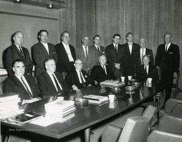 Seated, first on left Hans McCord; Bill Thompson, standing last on right; Chuck Haden, State Representative, standing sixth from left; John Pyles, standing fifth from left; Dr. Paul A. Miller, President of West Virginia University, seated, head of table.