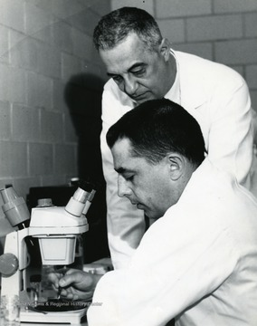 Professor of Medicine, Nicholas W. Fugo(standing), Instructor of Obstetrics and Gynecology, Dr. Roy L. Butcher (sitting).